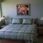 "Main bedroom has private bath, Cal King bed, 26"" TV & ocean view"