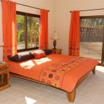 Costa Rican teak furniture graces all 3 bedrooms.