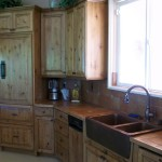 The kitchen boasts custom cabinets, Viking stove and Sub-Zero refrigerator